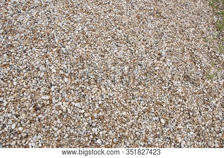 Smooth And Polished. Pebble On Shingle Beach. Colorful Small Pebble And Stone Texture. Pebble Backgr