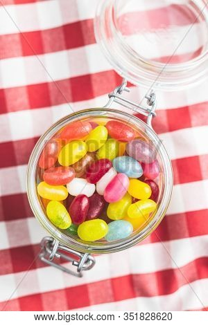 Fruity jellybeans. Tasty colorful jelly beans in glass jar.