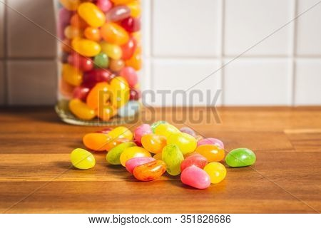 Fruity jellybeans. Tasty colorful jelly beans on kitchen table.