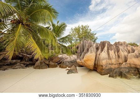 Curiouse Island And Beautiful Beach With Granite Stones In The Seychelles