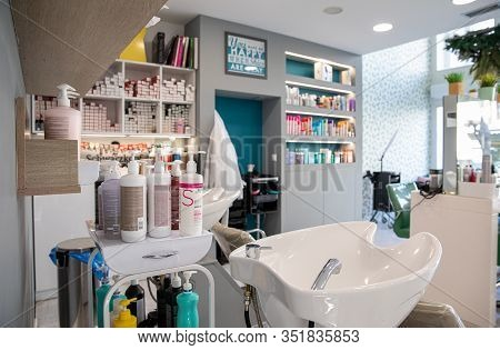 Athens, Greece - February 18, 2020: Washbasin, Cosmetics For Hair Care And Other Accessories In The
