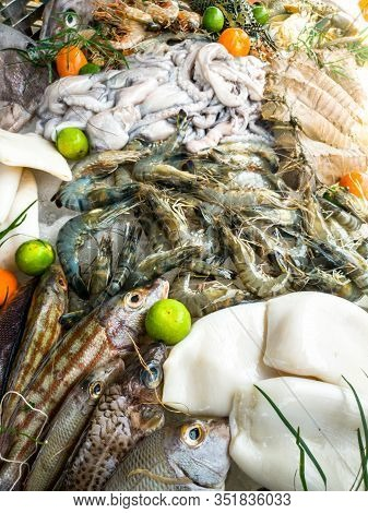 Closeup Image Of Fresh Fishes, Shrimps, Langoustine, Octopus And Lobster On The Counter At Seafood M