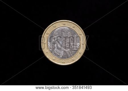 Austrian 1 Euro Coin From 2002, Obverse Showing Portrait Of Wolfgang Amadeus Mozart. Isolated On Bla