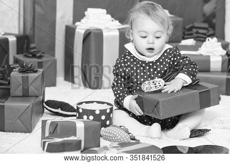 Baby First Christmas Once In Lifetime Event. Little Baby Girl Play Near Pile Of Gift Boxes. Gifts Fo