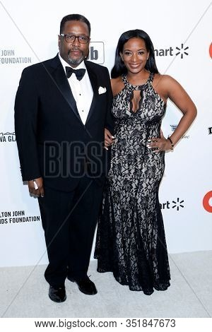 LOS ANGELES - FEB 9:  Wendell Pierce, Erika Woods at the 28th Elton John Aids Foundation Viewing Party at the West Hollywood Park on February 9, 2020 in West Hollywood, CA