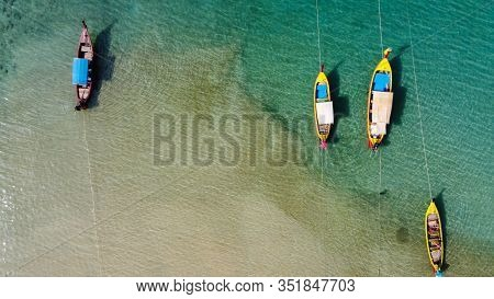 Aerial View Of Thai Traditional Wooden Longtail Boat On Phuket Beach, Thailand, Top View From Flying