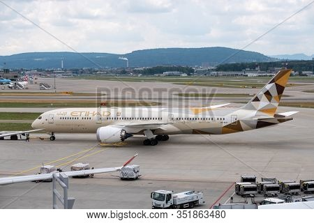 Zurich, Switzerland - July 19, 2018: Etihad airlines airplane preparing for take-off at day time in international airport
