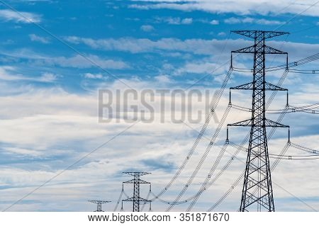 High Voltage Electric Pole And Transmission Line. Electricity Pylons. Power And Energy. Energy Conse