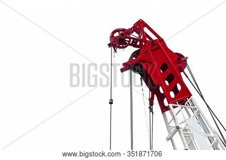 Construction Crane For Heavy Lifting Isolated On White Background. Construction Industry. Closeup Re
