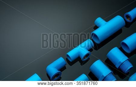 Set Of Blue Pvc Pipe Fittings Isolated On Dark Background. Blue Plastic Water Pipe. Pvc Accessories