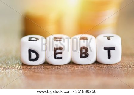 Debt Dices On Money Coin Stack Staircase Step Up / Increased Liabilities From Exemption Debt Consoli