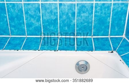 Damp Mold Growing On Tile Grout And Silicon Sealant In A Bathroom Shower Tub