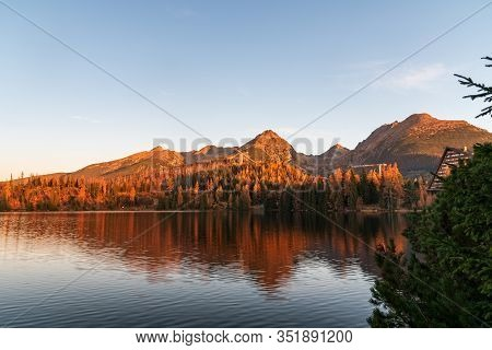 Strbske Pleso Lake With Peaks Above In Vysoke Tatry Mountains In Slovakia During Autumn Morning With