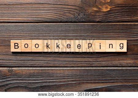 Bookkeeping Word Written On Wood Block. Bookkeeping Text On Wooden Table For Your Desing, Top View C