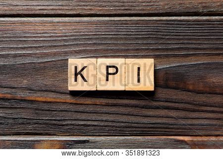 Kpi Word Written On Wood Block. Kpi Text On Table, Concept