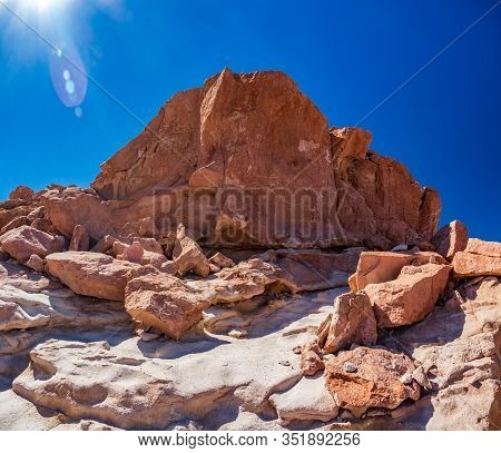 Huge Stone With Petroglyphs Under The Sun In Atacama, Chile