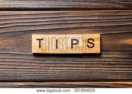 Tips Word Written On Wood Block. Tips Text On Table, Concept