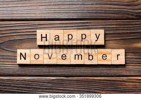 Happy November Word Written On Wood Block. Happy November Text On Table, Concept