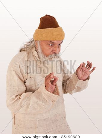 Expression of old indian man asking something to someone in winter poster