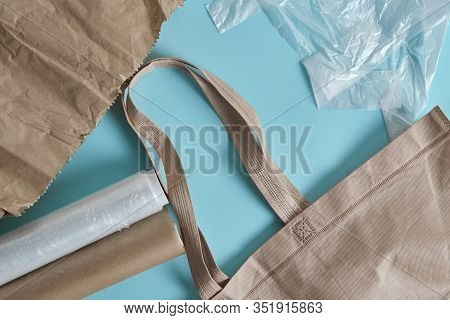 Brown Empty Tote Bag Next To Eco Unfriendly Pouches And Wrap