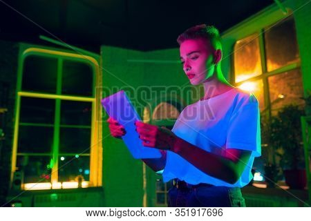 Serious. Cinematic Portrait Of Stylish Woman In Neon Lighted Interior. Toned Like Cinema Effects, Br
