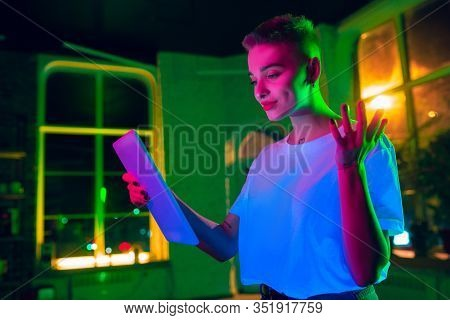 Delightful. Cinematic Portrait Of Stylish Woman In Neon Lighted Interior. Toned Like Cinema Effects,