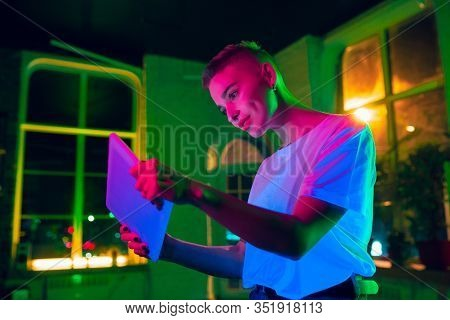 Gaming. Cinematic Portrait Of Stylish Woman In Neon Lighted Interior. Toned Like Cinema Effects, Bri
