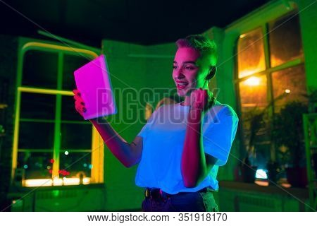 Winning. Cinematic Portrait Of Stylish Woman In Neon Lighted Interior. Toned Like Cinema Effects, Br