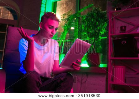 Asking. Cinematic Portrait Of Stylish Woman In Neon Lighted Interior. Toned Like Cinema Effects, Bri