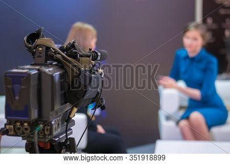 Television Video Camera Recording Interview In Broadcast News Studio. Blurred Background. Media, Pro