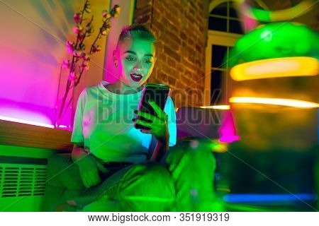 Chatting. Cinematic Portrait Of Stylish Woman In Neon Lighted Interior. Toned Like Cinema Effects, B