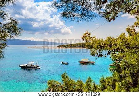 Boats And Pine Trees Near Zlatni Rat Or Golden Horn Or Golden Cape Beach In Bol, Brac Island, Croati