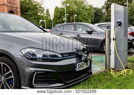 Glasgow, Scotland - July 31, 2019: The Volkswagen Golf Gte Electric Plug-in Car Charged At The Publi