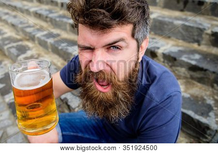 Celebration Concept. Guy Having Rest With Draught Beer. Hipster On Cheerful Winking Face Drinks Beer