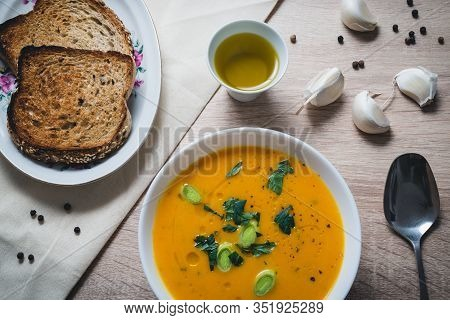 Close Up Pumpkin Soup Food On Table. Healthy Food. Healthy Lunch Food. Nutritious Food. Plate With P