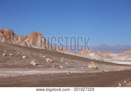 Atacama Desert, Chile, Luna Valley Mountains, Arid Land With Hills And Mountains Under A Clear Blue
