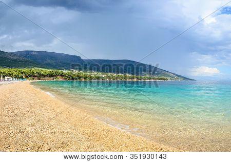 Pebble Beach Zlatni Rat Or Golden Horn Or Golden Cape In Bol Town, Brac Island, Croatia. Gravel Beac