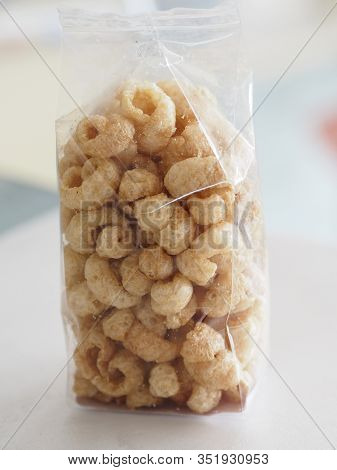 Pork Snack, Rind, Scratching Or Crackling Food Packed In A Clear Plastic Bag