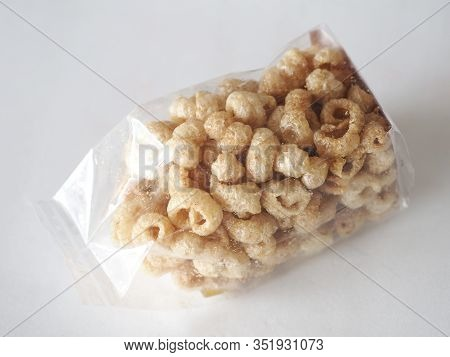 Pork Snack, Rind, Scratching Or Crackling Food Packed In A Clear Plastic Bag,