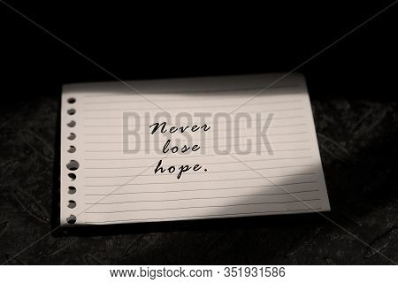 Inspirational Quote - Never Lose Hope A Self Simple Note Reminder On White Paper With Natural Light