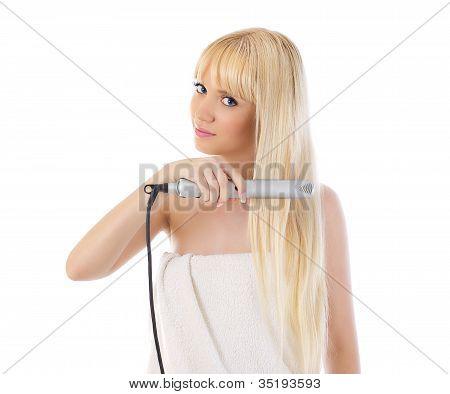 Woman Using Hair Straighteners