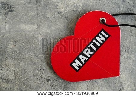Krakow, Poland 02.18.2020: Martini Lovers Heart Sign On A Grey Background. Promotional Packaging, Re
