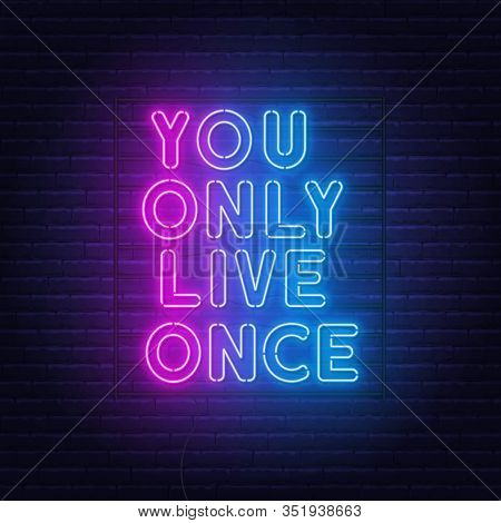 You Only Live Once Neon Lettering On A Brick Wall Background.