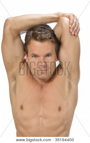 Muscular athletic shirtless man performing triceps stretch on white background poster