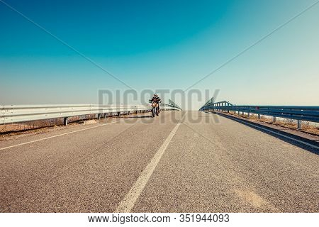 Solo Motorbiker Driving On An Empty Road  - Single Man Trip With His Motorbike