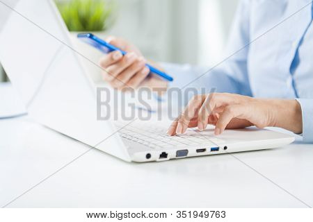Young Business Woman Working Using Laptop.
