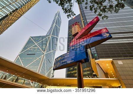 HONG KONG, CHINA - CIRCA JANUARY, 2019: low angle view of direction signs and skyscrapers in Hong Kong.