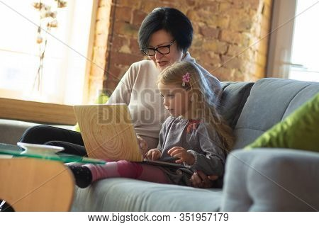 Time For Miracle. Happy Loving Family. Grandmother And Grandchild Spending Time Together. Watching C