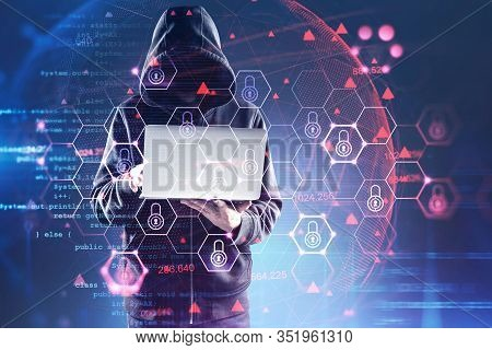 Unrecognizable Hacker In Hoodie With Laptop Committing Cyber Crime Over Blurry Blue Background With
