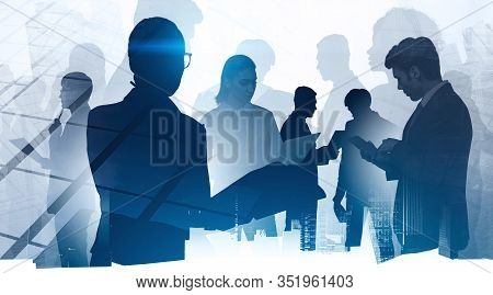 Silhouettes Of Business People Working In Abstract City. Concept Of Communication, Partnership And T